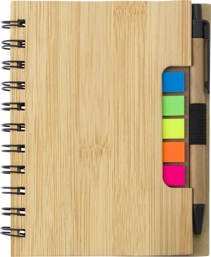 Trådbunden anteckningsbok med kulspetspenna